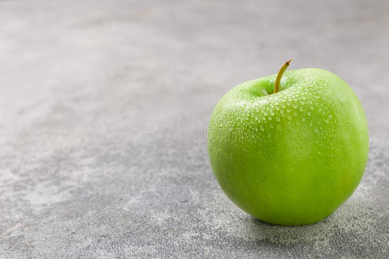 Juicy ripe green Apple with water drops stock photos
