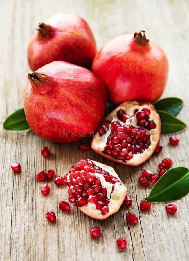Juicy and ripe pomegranates royalty free stock photos