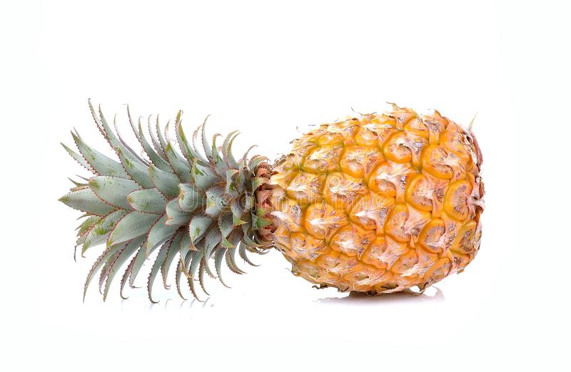 Juicy ripe sliced pineapple on white background royalty free stock images