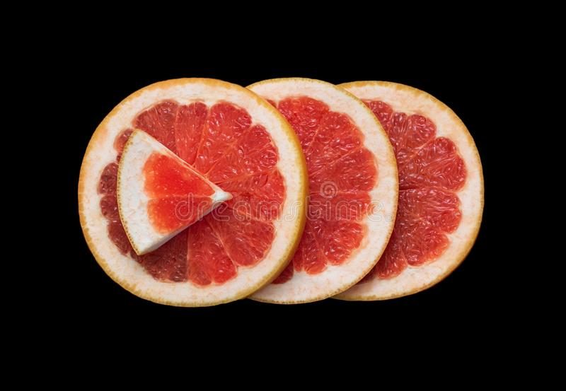 Juicy sliced grapefruit isolated on black background close up. Flat lay. Bright red grapefruit citrus fruit cut in half. Juicy sliced grapefruit isolated on stock photos