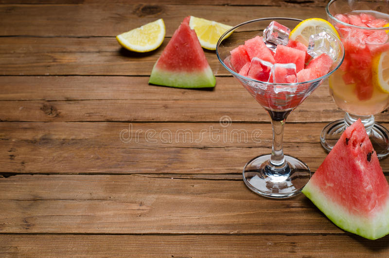Juicy slices of watermelon, a glass of watermelon slices, close-up on a brown wooden table, space for text. royalty free stock photos