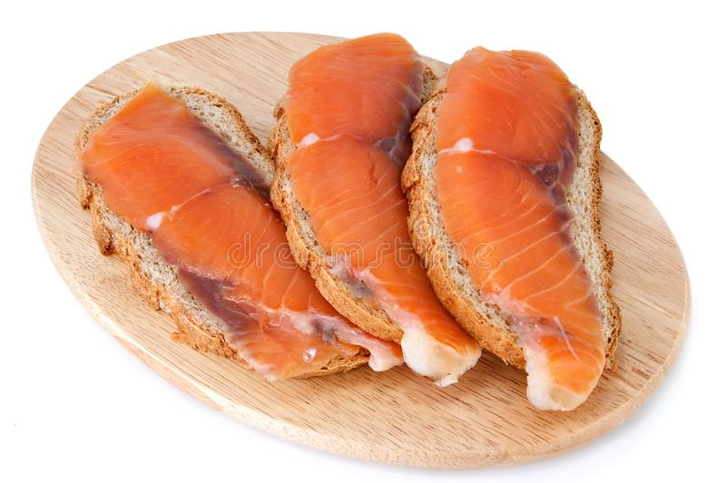 Juicy snack from slices salmon stock photo