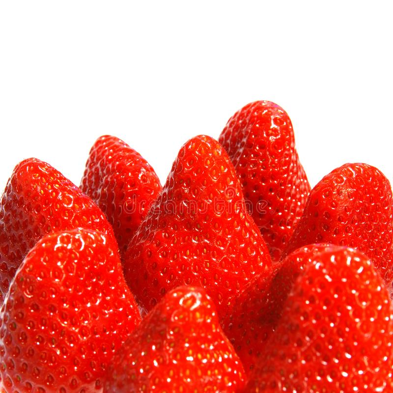 Juicy strawberries. Lots of fresh red strawberries huddled together stock photos