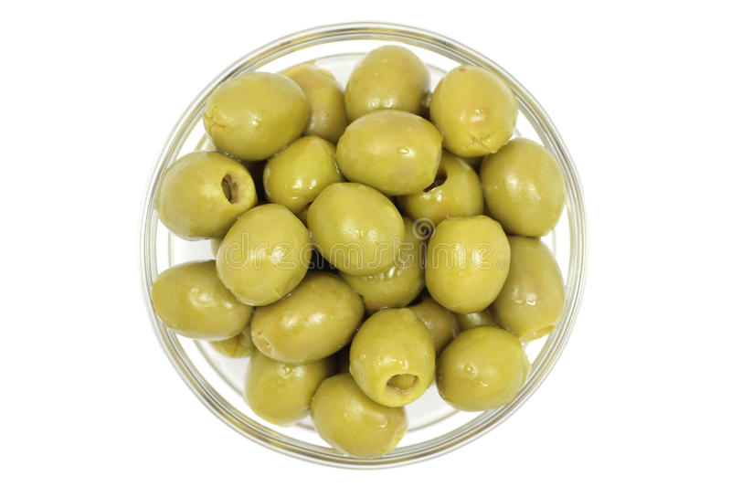 Juicy stuffed olives in a glass stock photo