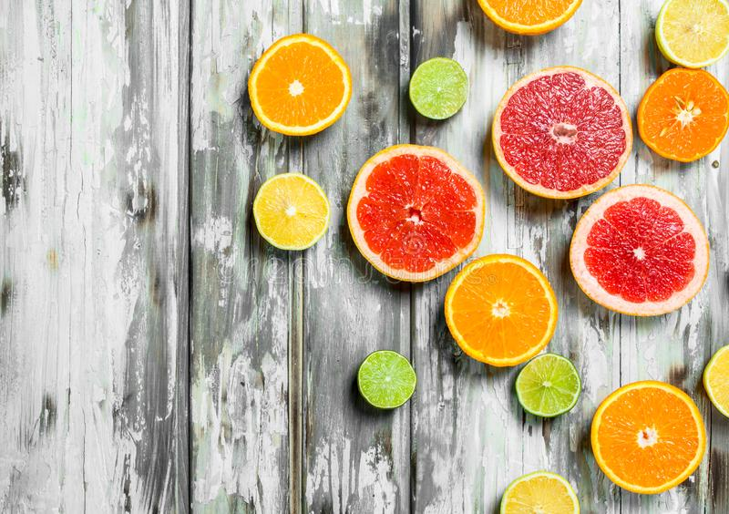 Juicy sweet citrus. On white wooden background royalty free stock photo