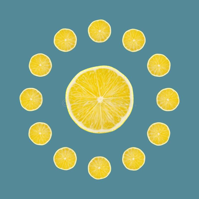 Juicy yellow slice of lemon fruit background, flat lay, clock composition.  royalty free stock photo