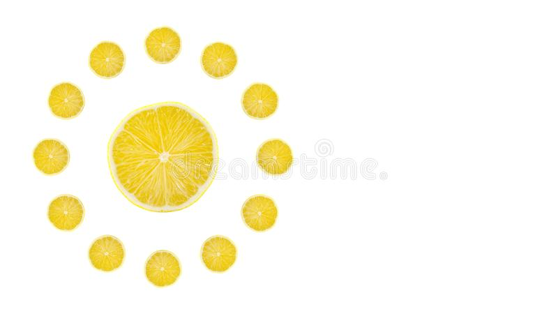 Juicy yellow slice of lemon fruit background, flat lay, clock composition. Copy space stock photography