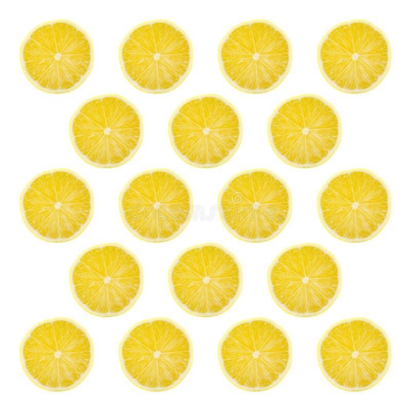 Juicy yellow slice of lemon fruit pattern background, flat lay.  royalty free stock photo