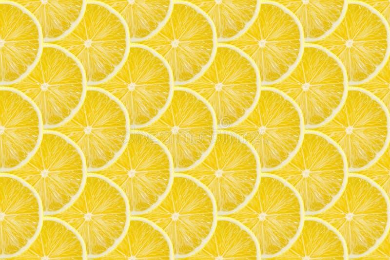 Juicy yellow slice of lemon fruit pattern background, flat lay.  stock photos
