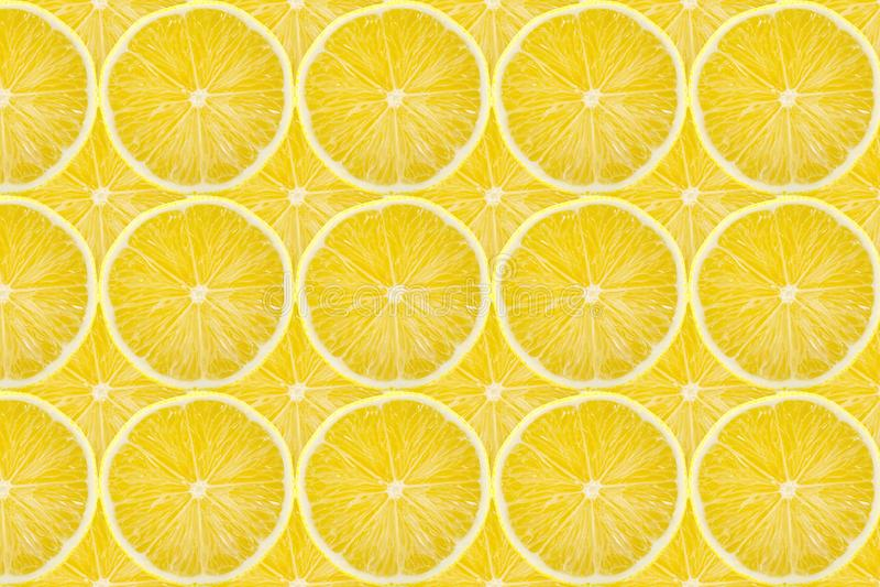 Juicy yellow slice of lemon fruit pattern background, flat lay.  royalty free stock image
