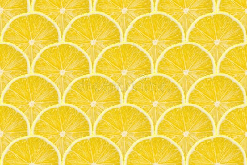 Juicy yellow slice of lemon fruit pattern background, flat lay.  stock photo