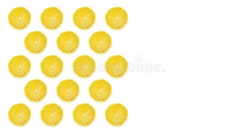Juicy yellow slice of lemon fruit pattern background, flat lay. Copy space royalty free stock images