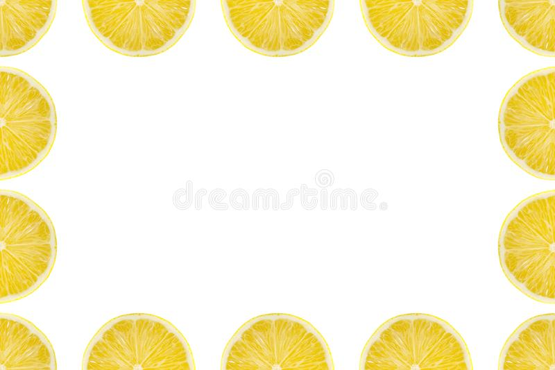 Juicy yellow slice of lemon fruit pattern background, flat lay with copy space, frame and border.  stock image