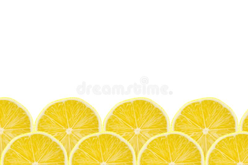 Juicy yellow slice of lemon fruit pattern background, flat lay with copy space, frame and border.  royalty free stock images