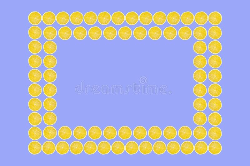 Juicy yellow slice of lemon fruit pattern background, flat lay with copy space, frame and border.  royalty free stock image