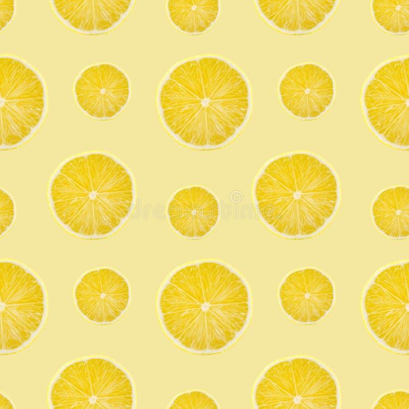 Juicy yellow slice of lemon fruit seamless pattern background, flat lay.  royalty free stock photography