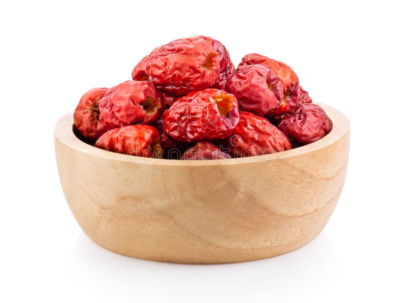 Jujube Chinese dried in wood bowl on white background. Full depth of field royalty free stock images