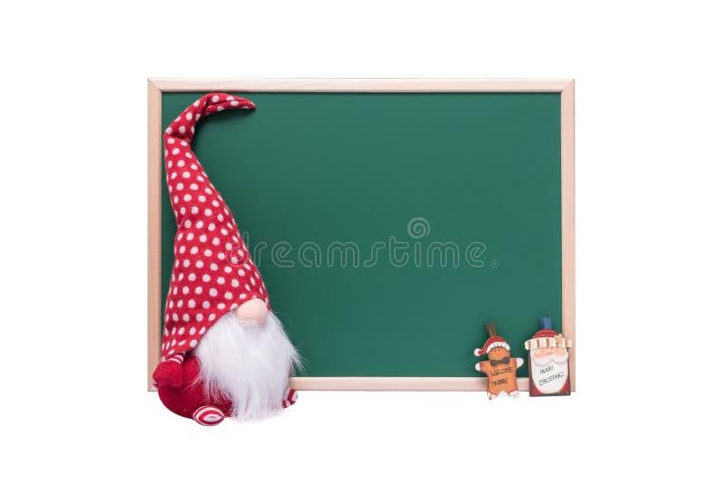 Jul älva, Santa Claus och Ginger Bread Man Ornament Beside royaltyfri bild