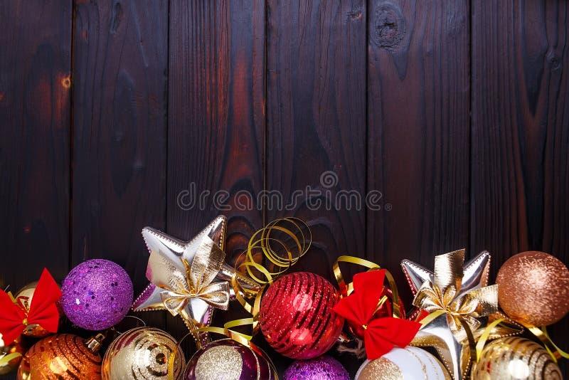 Jul bakgrund, sammansättning av festliga garneringar, stjärnor royaltyfri fotografi
