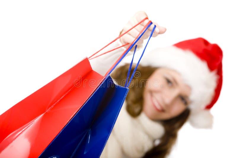 jul claus som gör den le kvinnan för santa shopping arkivfoto