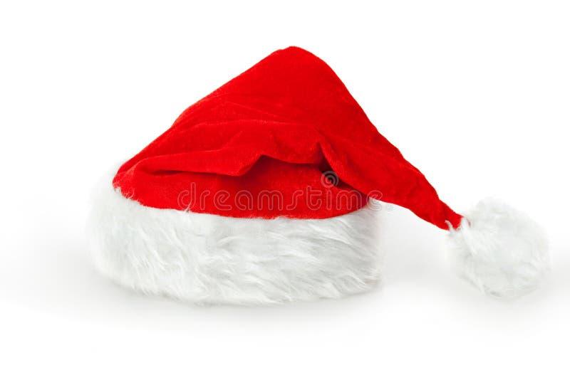 Jul- eller jultomtenhatt royaltyfri bild