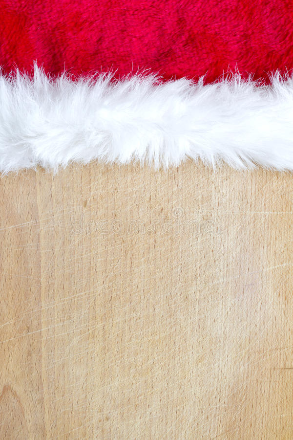 Jul gör sammandrag matbakgrund med den Santa Claus hatten royaltyfri foto