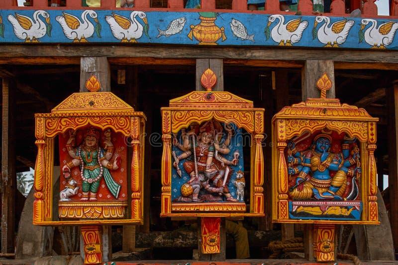 Goddesses statues at wheel of chariot rath yatra of jagannath ; Puri ; Orissa ; India. 24-jul-2007-Goddesses statues at wheel of chariot rath yatra of jagannath stock photography