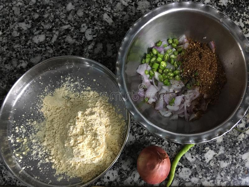Ingredients lined up for kanda bhajiOnion Pakora in monsoon Kalyan Maharashtra INDIA. 02 Jul 2019 ingredients lined up for kanda bhajiOnion Pakora in monsoon royalty free stock photography