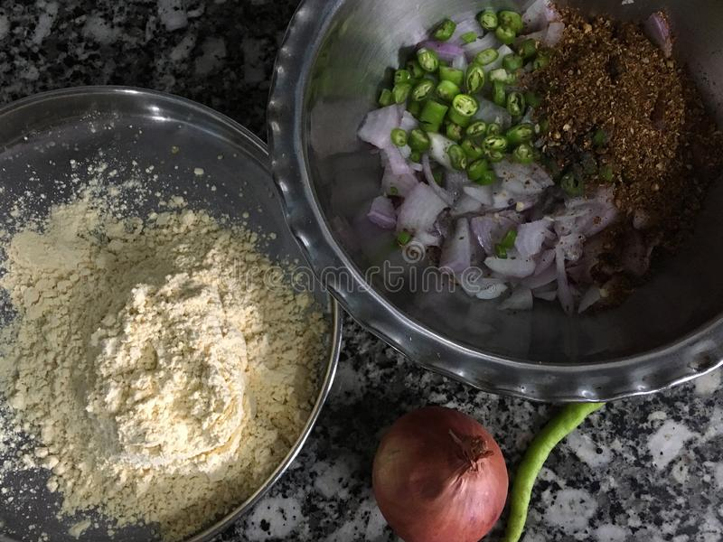 Ingredients lined up for kanda bhajiOnion Pakora in monsoon Kalyan Maharashtra INDIA. 02 Jul 2019ingredients lined up for kanda bhajiOnion Pakora in monsoon royalty free stock photo