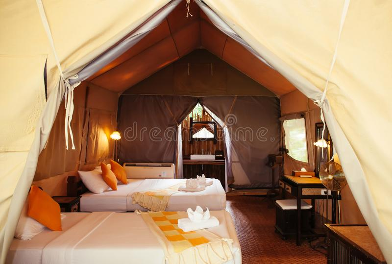Interior of luxurious camping resort in nature forest, glamping royalty free stock images