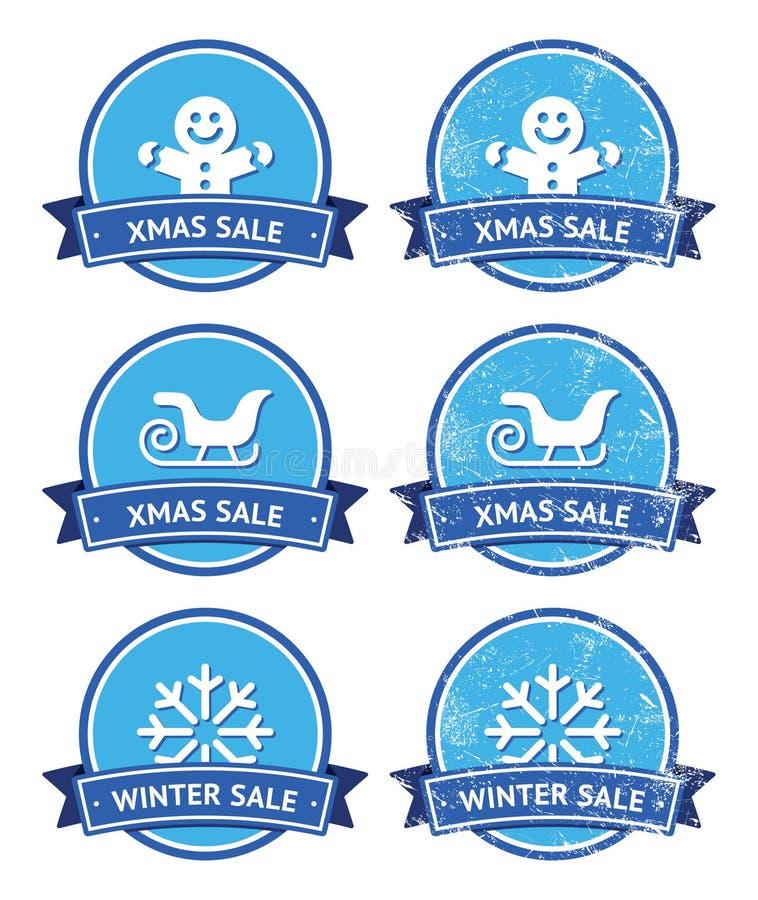 Jul och retro etiketter för vinterförsäljning vektor illustrationer