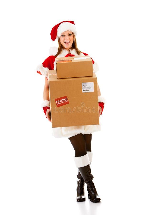 Jul: Santa Girl med bunten av askar royaltyfria foton