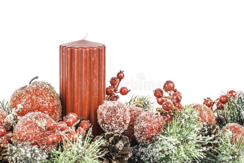 Jul Themed blomma- och stearinljusordning med rum för Tex arkivfoton