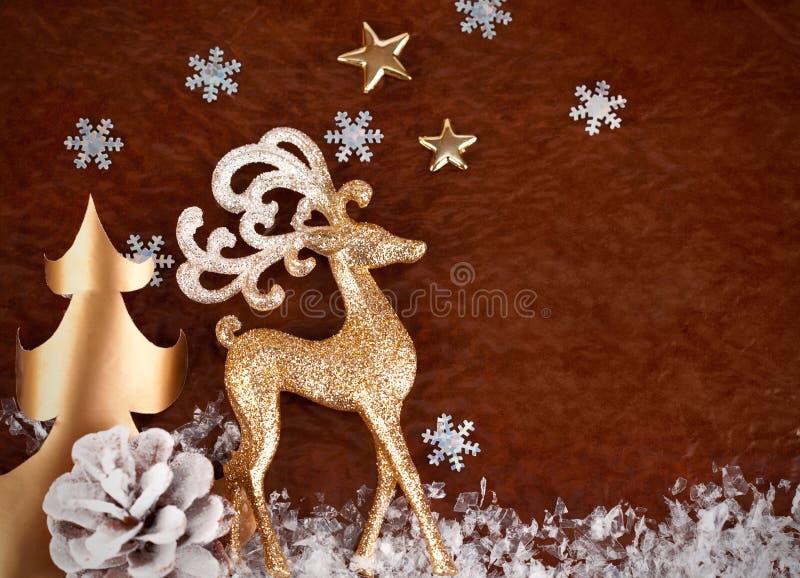 Julbakgrund med guldhjortar royaltyfria foton