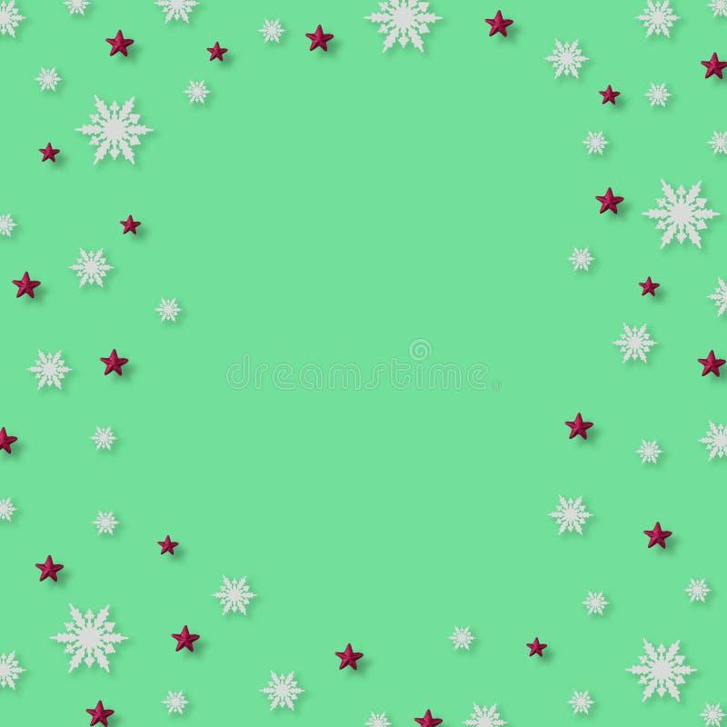 Julbakgrund med snöflingor och den röda stjärnamodellen, minsta begrepp för jul arkivbilder