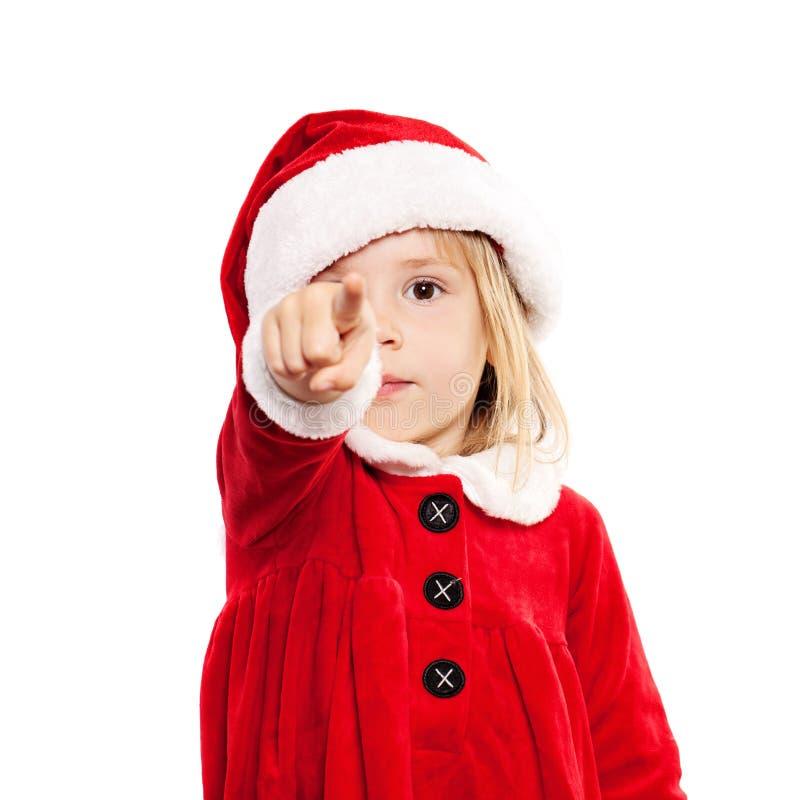 Julbarn i Santa Hat Point fingret royaltyfria foton