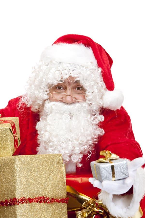 julclaus gåvor lyckliga santa arkivfoto
