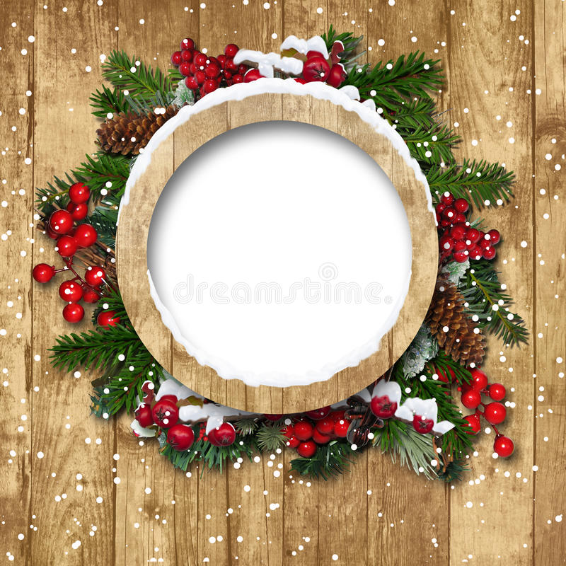 Julen inramar med garneringar på ett trä royaltyfria bilder