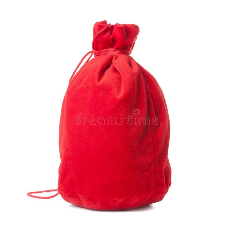 julen isolerade den röda säcken arkivfoto