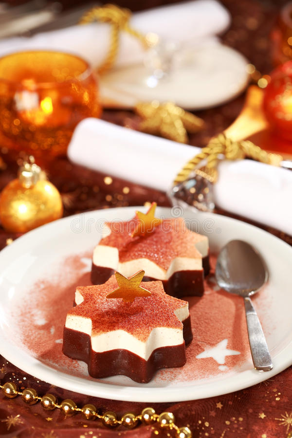 julen lagar mat med grädde is arkivbild
