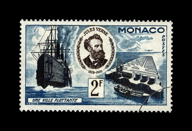 Jules Verne, famous science writer and Floating City, Monaco, circa 1955,. MONACO - CIRCA 1955: canceled postal stamp printed in Monaco shows Jules Verne ( royalty free stock image