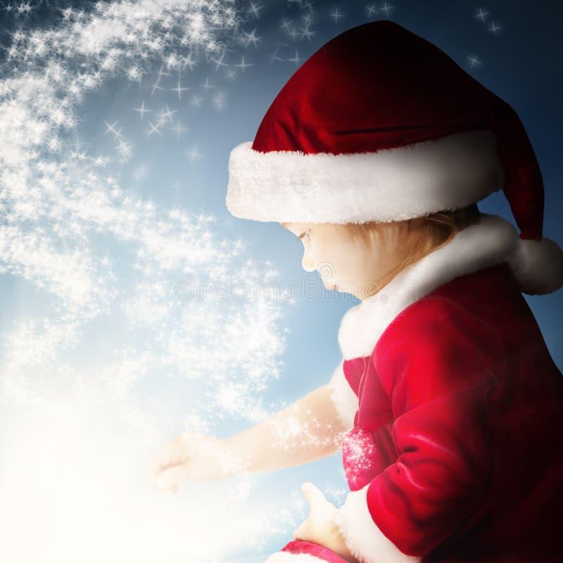 Julfantasibakgrund Behandla som ett barn och stjärnaljus royaltyfri foto