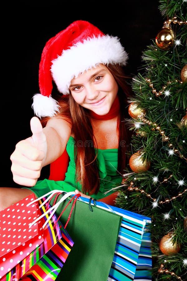 Download Julflicka Med Påsar Som Pekar Det Ok Tecknet Fotografering för Bildbyråer - Bild av gåva, mood: 27283483