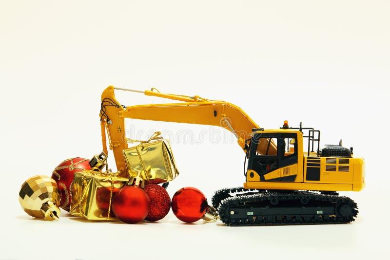 Julgåva med grävskopamodellen arkivfoto