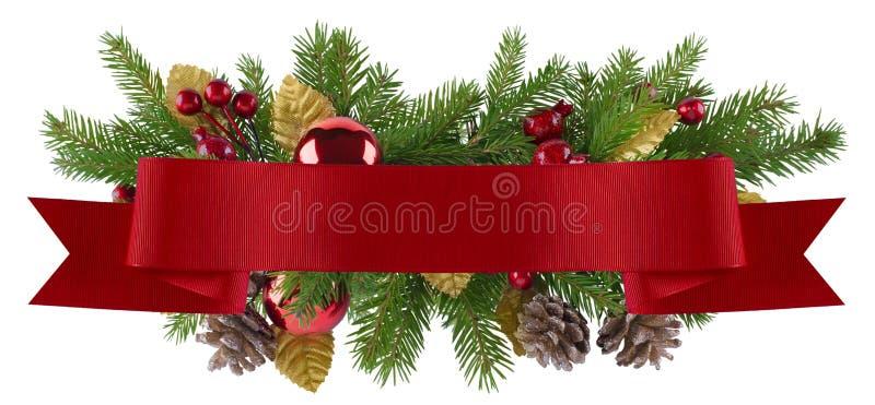 Julgarneringbeståndsdel med det raka röda bandet royaltyfri foto