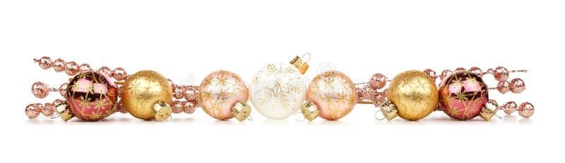 Julgräns av guld- och koppargarneringar som isoleras på vit royaltyfria bilder