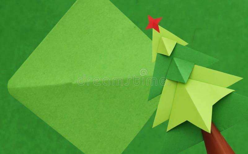 Julgran över grön bakgrund royaltyfri foto