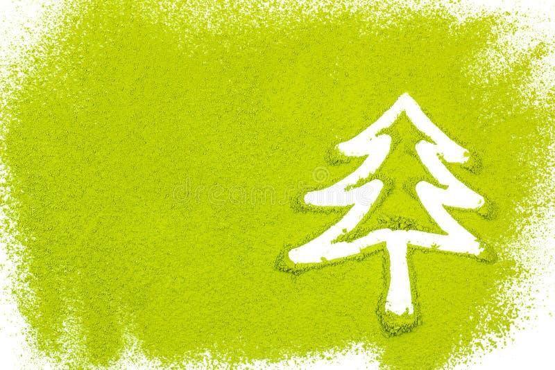 Julgran med pudrat grönt te royaltyfria bilder