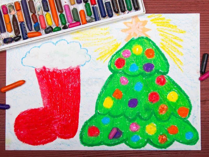 Julgran och röd julsocka royaltyfria foton