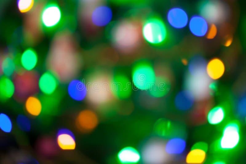 Julgranen tänder Bokeh som är suddig ut ur fokusbakgrund arkivbild